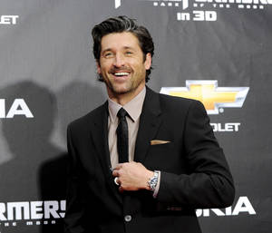 "photo - FILE - In this June 28, 2011 file photo, actor Patrick Dempsey attends the ""Transformers: Dark Of The Moon'"" premiere in Times Square in New York. Late Thursday night Jan. 3, 2013, Dempsey announced that his company, Global Baristas LLC, made the winning bid for Tully's Coffee.  (AP Photo/Evan Agostini, File)"