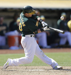 Photo - Oakland Athletics' Josh Donaldson connects for the game winning-single in the 11th inning of a baseball game against the Boston Red Sox on Sunday, July 14, 2013, in Oakland, Calif. The A's won 3-2. (AP Photo/Ben Margot)