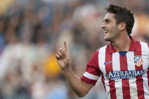 "Photo - Atletico de Madrid's Jorge Resurreccion ""Koke"" celebrates his goal during a Spanish La Liga soccer match between Malaga and Atletico de Madrid at the La Rosaleda stadium in Malaga, Spain, Saturday, Jan. 4, 2014. (AP Photo/Daniel Tejedor)"