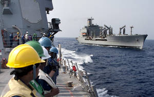 Photo -   In photo released by the U.S. Navy dated June 19, 2012, the USNS Rappahannock, right, is seen by the sailors assigned to the guided-missile destroyer USS James E. Williams after completing a replenishment at Red Sea. An Indian fisherman aboard a boat shot at by the U.S. Navy off Dubai's coast has told officials the crew received no warning before being fired upon, India's ambassador to the United Arab Emirates said Tuesday, July 17, 2012. One Indian was killed in the incident, and three of his countrymen were seriously wounded. The shooting happened Monday afternoon when a small boat rapidly approached the refueling ship USNS Rappahannock about 10 miles (15 kilometers) off Dubai's Jebel Ali port, according to the Navy. (AP Photo/MC3 Daniel Meshel, U.S. Navy)
