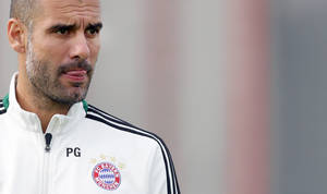 Photo - Bayern head coach Pep Guardiola of Spain watches his team during a last training session prior to the Champions League group D soccer match between FC Bayern Munich and Viktoria Plzen, in Munich, southern Germany, Tuesday, Oct. 22, 2013. Munich will face Plzen Wednesday. (AP Photo/Matthias Schrader)