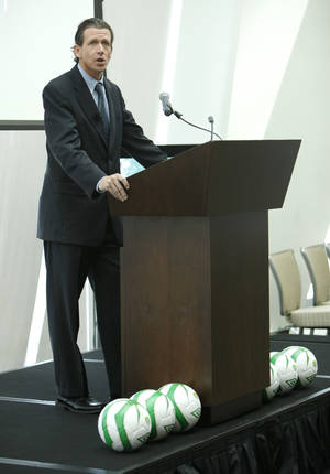 Photo - United Soccer Leagues President Tim Holt discusses Oklahoma City's new professional soccer team during an official announcement at the Devon Tower in Oklahoma City, OK, Tuesday, July 2, 2013,  Photo by Paul Hellstern, The Oklahoman