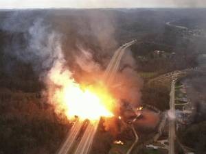 Photo - This image provided by the West Virginia State Police shows a fireball erupting across Interstate 77 from a gas line explosion in Sissonville, W. Va.,Tuesday Dec. 11, 2012. At least five homes went up in flames Tuesday afternoon and a badly damaged section of Interstate 77 was shut down in both directions near Sissonville after a natural gas explosion triggered an hour-long inferno that officials say spanned about a quarter-mile.  (AP Photo/West Virginia State Police)