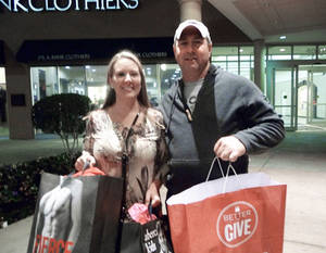 photo - Jeff and Stephanie Flowers, of Sulphur, leave Penn Square Mall early Friday after shopping.  PHOTOS BY KEVAN GOFF-PARKER, FOR THE OKLAHOMAN