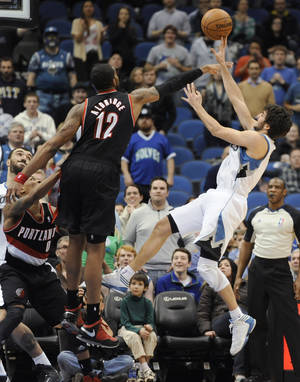 photo - Portland Trail Blazers' LaMarcus Aldridge (12) deflects a shot by Minnesota Timberwolves' Ricky Rubio during the fourth quarter of an NBA basketball game Monday, Feb. 4, 2013, in Minneapolis. The Trail Blazers won 100-98. (AP Photo/Hannah Foslien)