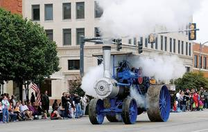 Photo - Historical items such as this steam-powered engine which was part of last year's parade are expected to be in this year's Cherokee Strip Celebration in Enid. (Enid News and Eagle photo)