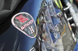 Photo - A sticker wishing the injured Tony Stewart  to get well is seen on the race car of Max Papis before a NASCAR Sprint Cup Series auto race at The Glen on Sunday, Aug. 11, 2013, in Watkins Glen, N.Y. (AP Photo/Charles Berch)