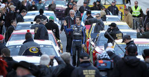 Photo - Jimmie Johnson waves to the crowd as he is introduced before leading a victory lap on the Las Vegas Strip during NASCAR Champions Week on Thursday, Dec. 5, 2013, in Las Vegas. (AP Photo/Isaac Brekken)
