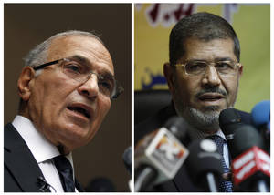 Photo -   FILE - COMBO - This combination of two photos shows Egyptian presidential candidates, from left, Ahmed Shafiq, and Mohammed Morsi. The chairman of Egypt's presidential election commission says the Muslim Brotherhood's candidate and Hosni Mubarak's last prime minister will context next month's runoff vote. Farouq Sultan said Monday the official final results show the Brotherhood's Mohammed Morsi and Ahmed Shafiq, a former air force commander, as the top two finishers in the first round of voting on May 23-24. He said Morsi won 5.76 million votes, while Shafiq garnered 5.5 million votes.(AP Photo/Khalil Hamra; Nasser Nasser, File)
