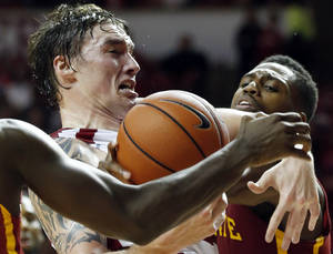 Photo - Oklahoma Sooner's Ryan Spangler is fouled going to the basket as the University of Oklahoma Sooners (OU) men defeat the Iowa State Cyclones (ISU) 87-82 in NCAA, college basketball at The Lloyd Noble Center on Saturday, Jan. 11, 2014  in Norman, Okla. Photo by Steve Sisney, The Oklahoman