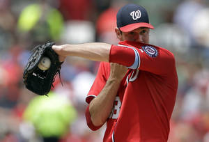 Photo - Washington Nationals starting pitcher Doug Fister wipes his face during the second inning of a baseball game against the St. Louis Cardinals, Sunday, June 15, 2014, in St. Louis. (AP Photo/Jeff Roberson)
