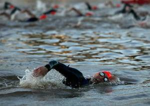 Photo - Athletes swim in the Oklahoma River during The Boathouse International Triathlon May 13. Photo by John Clanton