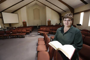 Photo - The Rev. Kathy McCallie, founding pastor of Church of the Open Arms, stands in the sanctuary of the church, 3131 N Pennsylvania.  <strong>Steve Gooch - The Oklahoman</strong>