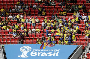 Photo - Ecuador fans sit between unoccupied seats during the group E World Cup soccer match between Switzerland and Ecuador at the Estadio Nacional in Brasilia, Brazil, Sunday, June 15, 2014.  (AP Photo/Themba Hadebe)
