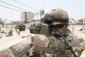 Photo - This handout photo, provided by the French Defense Ministry, shows French soldiers patrolling in Port Bouet. The United Nations mission in Ivory Coast began moving about 200 employees out of the main city Sunday. AP Photo