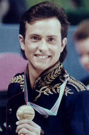 "Photo - FILE - In this Feb. 20, 1988 file photo, figure skater Brian Boitano shows off his Olympic gold medal, in Calgary, Alberta. Two days after being named to the U.S. delegation for Sochi, Boitano has announced he is gay. But the 1988 gold medalist says Thursday, Dec. 19, 2013,  in a statement that ""being gay is just one part of who I am. ... I hope we can remain focused on the Olympic spirit which celebrates achievement in sport by peoples of all nations."" (AP Photo/Jack Smith)"