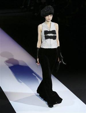Photo - A model wears a creation for Giorgio Armani women's Fall-Winter 2013-14 collection, part of the Milan Fashion Week, unveiled in Milan, Italy, Monday, Feb. 25, 2013. (AP Photo/Antonio Calanni)