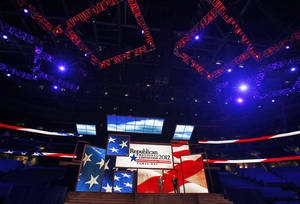 Photo -   Republican National Committee Chairman Reince Priebus, left, and convention CEO William Harris unveil the stage and podium for the 2012 Republican National Convention, Monday, Aug. 20, 2012, at the Tampa Bay Times Forum in Tampa, Fla. (AP Photo/Scott Iskowitz)