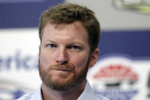 Photo -   Driver Dale Earnhardt Jr pauses as he talks about missing the next two races with his second concussion in the past six weeks during a news conference prior to practice for Saturday's NASCAR Bank of America 500 NASCAR Sprint Cup series auto race in Concord, N.C., Thursday, Oct. 11, 2012. (AP Photo/Chuck Burton)