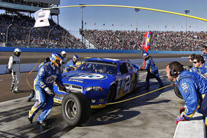 Photo -   Brad Keselowski (2) pits during the NASCAR Sprint Cup Series auto race, Sunday, Nov. 11, 2012, at Phoenix International Raceway in Avondale, Ariz. (AP Photo/Matt York)