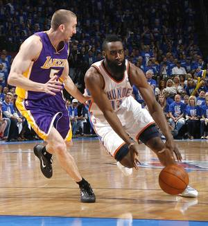 photo - NBA BASKETBALL / LOS ANGELES LAKERS: Oklahoma City&#039;s James Harden (13) tries to get past Los Angeles&#039; Steve Blake (5) during Game 1 in the second round of the NBA playoffs between the Oklahoma City Thunder and the L.A. Lakers at Chesapeake Energy Arena in Oklahoma City, Monday, May 14, 2012. Photo by Sarah Phipps, The Oklahoman
