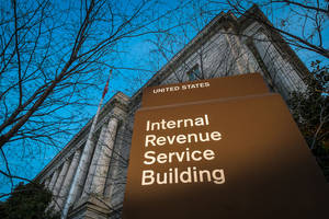Photo - FILE -This April 13, 2014 file photo shows the headquarters of the Internal Revenue Service (IRS) in Washington. Tuesday, April 15, is the federal tax filing deadline for most Americans. (AP Photo/J. David Ake, File)