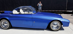 photo - Joe Gitzendanner of Mustang, takes photos of one of Starbird's custom cars on display at the fair. Custom car builder and designer Darryl Starbird has brought a half-dozen of his cars from the National Rod & Custom Car Hall of Fame Museum to the Oklahoma State Fair. The museum is located in Afton.  This photo taken Monday, Sep. 17, 2012,  Photo by Jim Beckel, The Oklahoman.