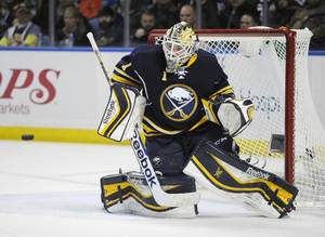 Photo - Buffalo Sabres goaltender Jhonas Enroth, of Sweden, gets beat for a goal from Edmonton Oilers' Justin Schultz during the second period of an NHL hockey game in Buffalo, N.Y., Monday, Feb 3, 2014. (AP Photo/Gary Wiepert)