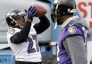 photo - Baltimore Ravens running back Ray Rice, left, catches a pass as linebacker Ray Lewis walks past during an NFL Super Bowl XLVII football practice on Wednesday, Jan. 30, 2013, in New Orleans. The Ravens face the San Francisco 49ers in Super Bowl XLVII on Sunday, Feb. 3. (AP Photo/Patrick Semansky)