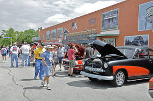 Photo - Visitors check out the car show during the Bethany 66 Festival on Saturday. PHOTO BY M. TIM BLAKE, FOR THE OKLAHOMAN <strong></strong>