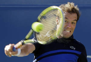 Photo - Richard Gasquet, of France, returns a shot to David Ferrer, of Spain, during the quarterfinals of the 2013 U.S. Open tennis tournament, Wednesday, Sept. 4, 2013, in New York. (AP Photo/Kathy Willens)