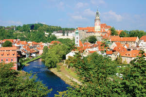 photo - With its awe-inspiring castle, delightful Old Town of shops and cobbled lanes, characteristic little restaurants, and easy canoeing options, Ceský Krumlov has been discovered — but not spoiled — by tourists. (Photo by Rick Steves)