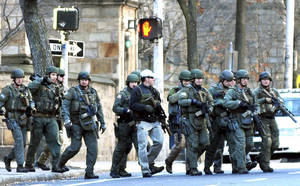 Photo - Police respond to the reports of a gunman on Yale campus Monday, Nov. 25, 2013, in New Haven, Conn. A lockdown remained in effect on the Old Campus Monday afternoon as police search rooms to confirm that no gunman is on campus.  (AP Photo/New Haven Register,  Arnold Gold)