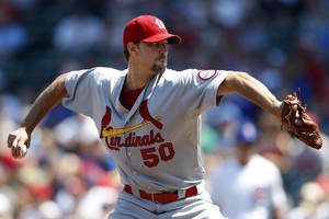 Photo - St. Louis Cardinals starting pitcher Adam Wainwright throws against the Chicago Cubs during the first inning of a baseball game on Sunday, Aug. 18, 2013, in Chicago. (AP Photo/Andrew A. Nelles)