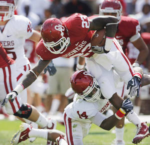 Photo - COLLEGE FOOTBALL: Brandon Williams (23) is tackled by Aaron Colvin (14) during the University of Oklahoma Sooners (OU) Spring Football game at Gaylord Family-Oklahoma Memorial Stadium on Saturday, April 16, 2011, in Norman, Okla.   Photo by Steve Sisney, The Oklahoman ORG XMIT: KOD