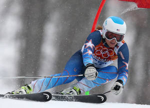 Photo - United States' Julia Mancuso passes a gate in the first run of the women's giant slalom at the Sochi 2014 Winter Olympics, Tuesday, Feb. 18, 2014, in Krasnaya Polyana, Russia. (AP Photo/Alessandro Trovati)