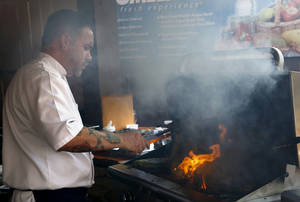Photo -  Jonas Favela of Boulevard Steakhouse grills during Open Flame at American Propane in Oklahoma City. Photo by Sarah Phipps, The Oklahoman  <strong>SARAH PHIPPS -  SARAH PHIPPS </strong>