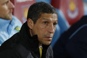 Photo - FILE - In this Tuesday, Feb. 11, 2014, file photo, Norwich City's manager Chris Hughton looks on from the dugout before the start of their English Premier League soccer match against West Ham United at Upton Park, London. The Premier League club fired Hughton because it is petrified of a costly relegation. After losing to West Bromwich on Saturday, the team is five points above the relegation zone with five matches remaining, Delia Smith, the co-owner who made her name and fortune from cook books and television shows, will fear missing out on at least $60 million in television revenue next season in the second tier. (AP Photo/Sang Tan, File)