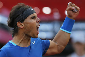 Photo - Rafael Nadal from Spain celebrates a point during a Madrid Open tennis tournament final match against Kei Nishikori from Japan in Madrid, Spain, Sunday, May 11, 2014. (AP Photo/Andres Kudacki)