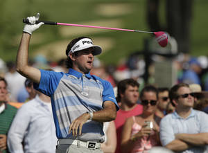 Photo - Bubba Watson watches his tee shot on the 15th hole during the final round of the Memorial golf tournament on Sunday, June 1, 2014, in Dublin, Ohio. (AP Photo/Jay LaPrete)