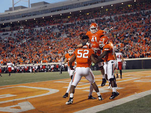 photo - OSU / CELEBRATION: Oklahoma State celebrates a touchdown on a blocked punt during a college football game between Oklahoma State University and the Texas Tech University (TTU) at Boone Pickens Stadium in Stillwater, Okla., Saturday, Nov. 17, 2012. Photo by Sarah Phipps, The Oklahoman
