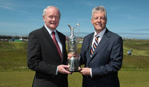 Photo - Northern Ireland Deputy First Minister Martin McGuinness, left, and First Minister Peter Robinson hold the Claret Jug trophy for the media to announce that golf's oldest championship would return to Royal Portrush in Northern Ireland, Monday June 16, 2014. (AP Photo/PA, Niall Carson) UNITED KINGDOM OUT  NO SALES  NO ARCHIVE