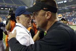 Photo - Oklahoma State coach Mike Gundy, right, talks with Texas San Antonio coach Larry Coker, left, following an NCAA college football game, Saturday,  Sept. 7, 2013, in San Antonio. Oklahoma State won 56-35. (AP Photo/Eric Gay)
