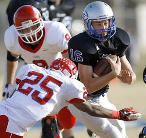 Photo - Guthrie's Bryan Dutton tries to get past Durant's Gabriel Louis during the first round of the Class 5A high school football playoffs in Guthrie, Okla., Saturday, Nov. 12, 2011. Photo by Bryan Terry, The Oklahoman