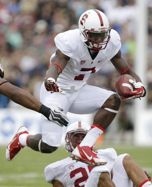 Photo - Stanford wide receiver Ty Montgomery (7) runs the ball against Army during the second half of an NCAA college football game on Saturday, Sept. 14, 2013, in West Point, N.Y. Stanford won, 34-20. (AP Photo/Mike Groll)