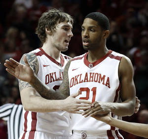 Photo - Ryan Spangler, left, Cameron Clark and the Oklahoma men's basketball team can still wrap up the No. 2 seed in the Big 12 Tournament.