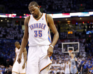 Photo - Oklahoma City's Kevin Durant (35) walks to the Memphis basket after a Thunder foul late in overtime during Game 2 in the first round of the NBA playoffs between the Oklahoma City Thunder and the Memphis Grizzlies at Chesapeake Energy Arena in Oklahoma City, Monday, April 21, 2014. Memphis won 111-105 in overtime. Photo by Nate Billings, The Oklahoman