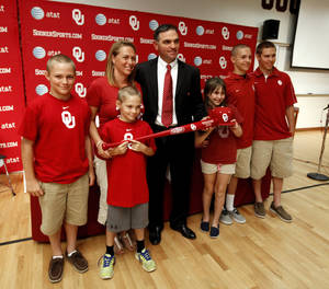 Photo - Pete Hughes poses with his wife and children, Dominic, 12, wife Debby, P.J., 8, Grace, 10, Hal, 14, and Thomas, 16 as he is introduced as the University of Oklahoma (OU) Sooners new baseball coach on Thursday, June 27, 2013 in Norman, Okla. Photo by Steve Sisney, The Oklahoman