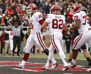 Photo - Oklahoma's Blake Bell (10) celebrates after scoring a touchdown during a college football game between the University of Oklahoma (OU) and Texas Tech University at Jones AT&T Stadium in Lubbock, Texas, Saturday, Oct. 6, 2012. Photo by Bryan Terry, The Oklahoman