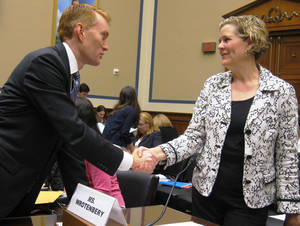 photo - U.S. Rep. James Lankford greets Oklahoma Corporation Commission official Lori Wrotenbery on Thursday on Capitol Hill before a House subcommittee hearing. Photo by Chris Casteel, The Oklahoman